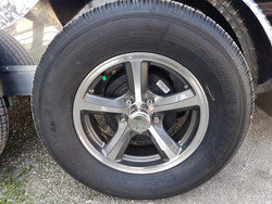 "ALUMINUM WHEELS W/ 15"" RADIAL TIRES"